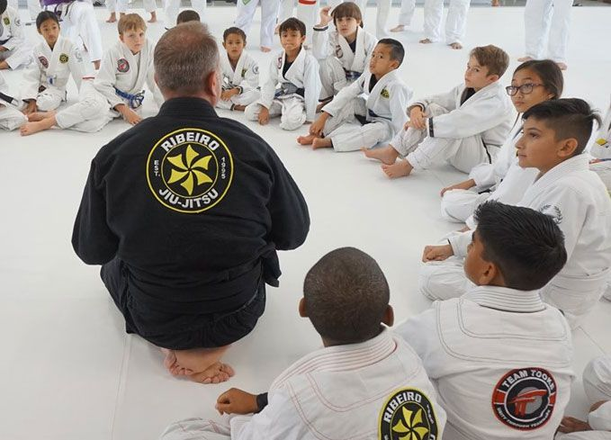 instructor talking to martial arts students